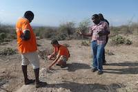 Geologist explaining the layer structure of Mirerani Hills, Tanzania